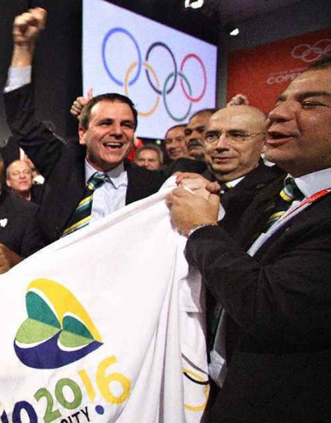The Mayor of Rio Eduardo Paes and the Governor of the state Rio de Janeiro Sérgio Cabral celebrate the achievement of Rio to host the Olympics